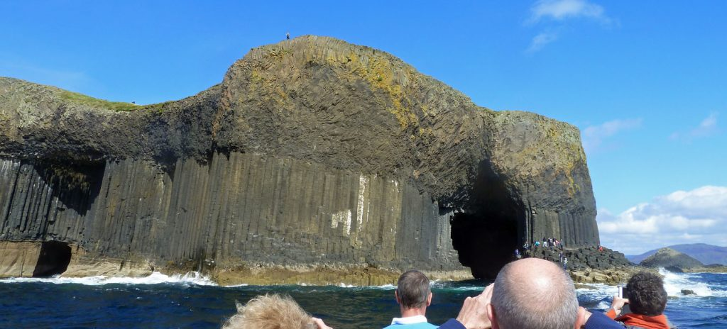 Approaching Fingal's Cave (right). Boat Cave on the left.